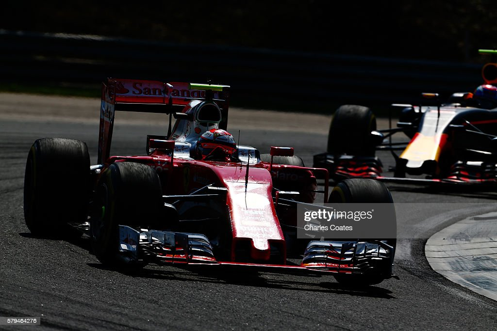 Kimi Raikkonen of Finland driving the Scuderia Ferrari SF16H Ferrari 059/5 turbo leads Max Verstappen of the Netherlands driving the Red Bull Racing...