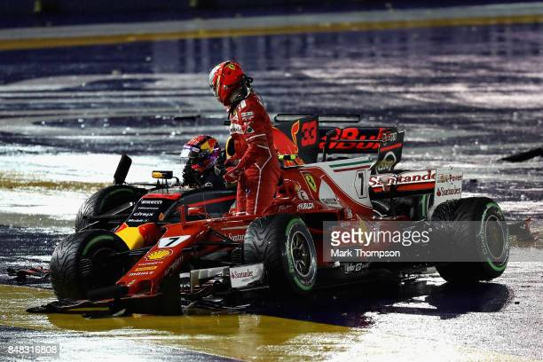 Kimi Raikkonen of Finland driving the Scuderia Ferrari SF70H and Max Verstappen of the Netherlands driving the Red Bull Racing Red BullTAG Heuer RB13...