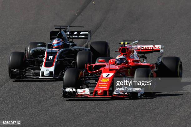 Kimi Raikkonen of Finland driving the Scuderia Ferrari SF70H battles with Romain Grosjean of France driving the Haas F1 Team HaasFerrari VF17 Ferrari...
