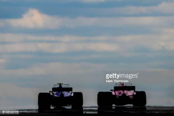 Kimi Raikkonen of Finland driving the Scuderia Ferrari SF70H follows Pascal Wehrlein of Germany driving the Sauber F1 Team Sauber C36 Ferrari on...