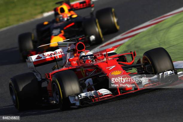 Kimi Raikkonen of Finland driving the Scuderia Ferrari SF70H leads Max Verstappen of the Netherlands driving the Red Bull Racing Red BullTAG Heuer...