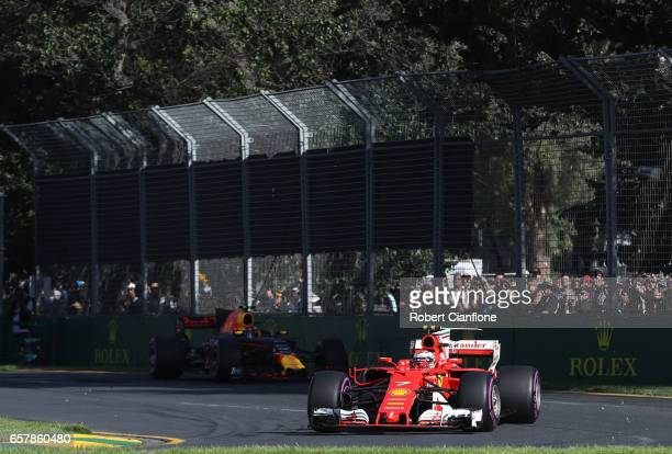 Kimi Raikkonen of Finland driving the Scuderia Ferrari SF70H leads Max Verstappen of the Netherlands driving the Red Bull Racing Red BullTAG Heuer...