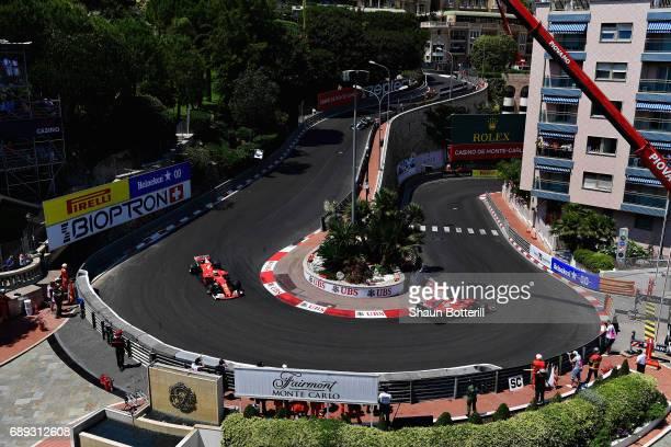 Kimi Raikkonen of Finland driving the Scuderia Ferrari SF70H leads Sebastian Vettel of Germany driving the Scuderia Ferrari SF70H on track during the...