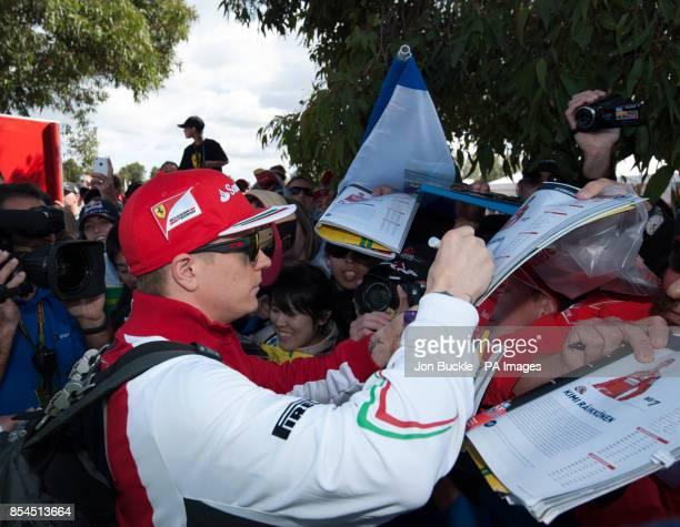 Kimi Raikkonen of Scuderia Ferrari signs autographs ahead of the 2014 Australian Grand Prix at Albert Park Melbourne Australia