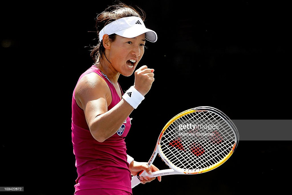 Kimiko Date Krumm of Japan celebrates a point against Monica Miculescu of Romania during the Rogers Cup at Stade Uniprix on August 17 2010 in...