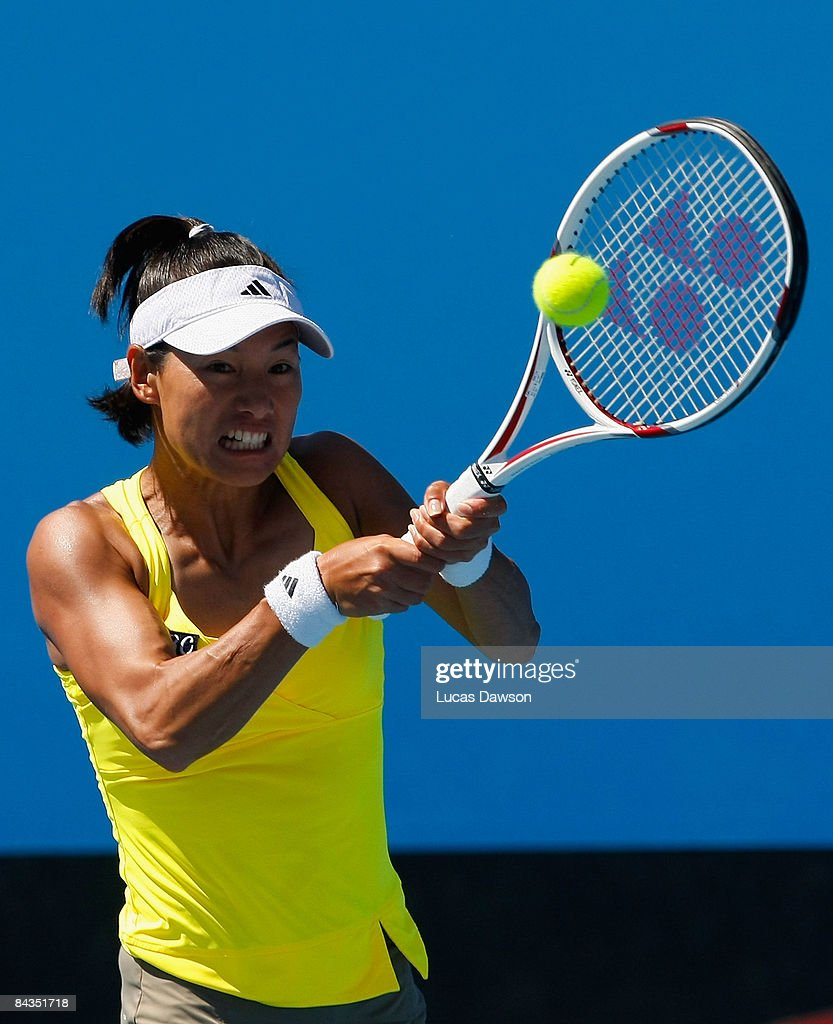 Kimiko Date Krumm of Japan plays a backhand in her first round match against Kaia Kanepi of Estonia during day one of the 2009 Australian Open at Melbourne Park on January 19, 2009 in Melbourne, Australia.