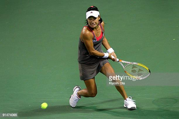 Kimiko Date Krumm of Japan returns a shot in her match against Ksenia Lykina of Russia during day two of the Rakuten Open Tennis tournament at Ariake...