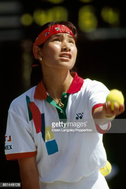 Kimiko Date of Japan in action during a women's singles match at the Wimbledon Lawn Tennis Championships in London circa June 1990