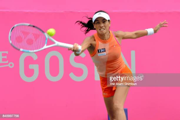 Kimiko Date of Japan plays a forehand during her singles first round match against Aleksandra Krunic of Serbia during day two of the Japan Women's...