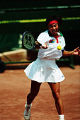 Kimiko Date of Japan plays a forehand in the Tennis Women's Singles first round match against Rene Simpson of Canada during the Barcelona Summer...