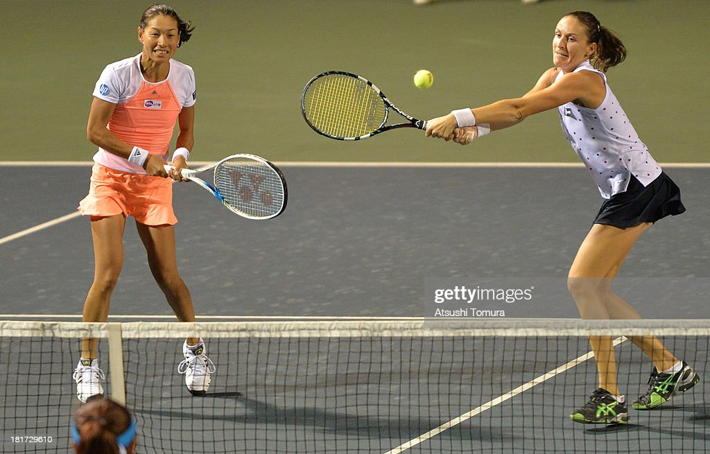 Kimiko Date-Krumm of Japan (L) and Arantxa Parra Santonja of Spain in action during their match against Hao-Ching Chan of Chinese Taipei and Liezel Huber of the United States in the womens doubles first round match during day three of the Toray Pan Pacific Open at Ariake Colosseum on September 24, 2013 in Tokyo, Japan.