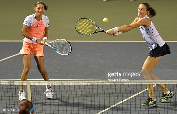 Kimiko DateKrumm of Japan and Arantxa Parra Santonja of Spain in action during their match against HaoChing Chan of Chinese Taipei and Liezel Huber...