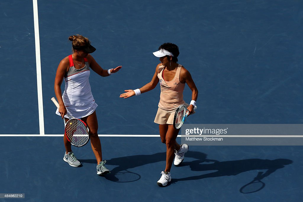 Kimiko DateKrumm of Japan and Barbora Zahlavova Strycova of the Czech Republic react against Andrea Hlavackova of the Czech Republic and Jie Zheng of...