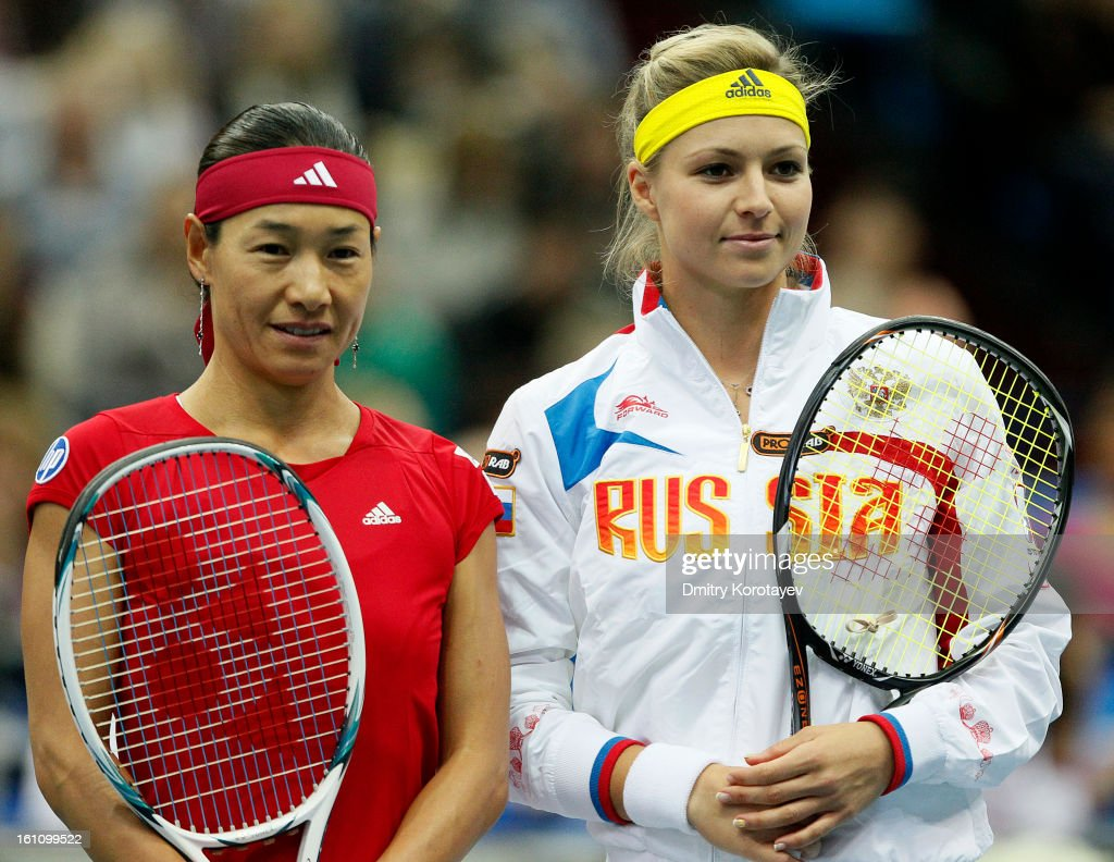 Kimiko Date-Krumm (L) of Japan and Maria Kirilenko of Russia pose for photographers before day one of the Federation Cup 2013 World Group Quarterfinal match between Russia and Japan at Olympic Stadium on February 09, 2013 in Moscow, Russia.