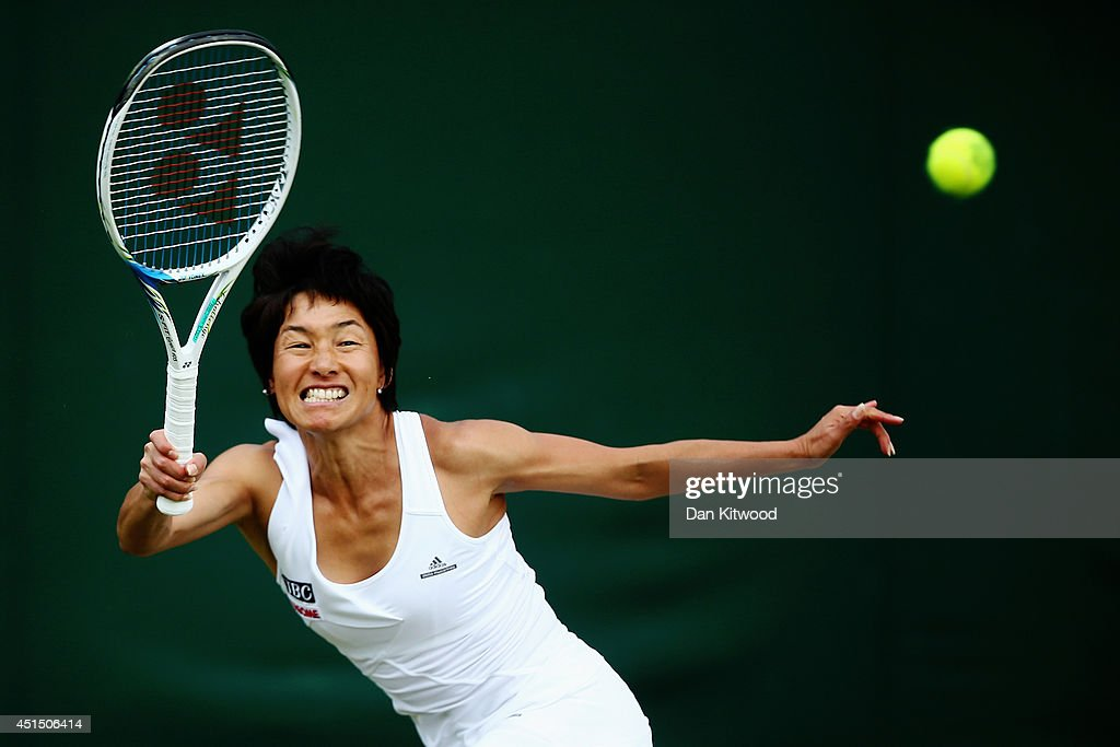 <a gi-track='captionPersonalityLinkClicked' href=/galleries/search?phrase=Kimiko+Date&family=editorial&specificpeople=623768 ng-click='$event.stopPropagation()'>Kimiko Date</a>-Krumm of Japan during her Ladies Doubles Second round match with Barbora Zahlavova Strycova of Czech Republic against Ashleigh Barty and Casey Dellacqua of Australia on day seven of the Wimbledon Lawn Tennis Championships at the All England Lawn Tennis and Croquet Club on June 30, 2014 in London, England.