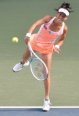 Kimiko DateKrumm of Japan in action during her women's singles first round match against Anastasia Rodionova of Australia during day two of the Toray...