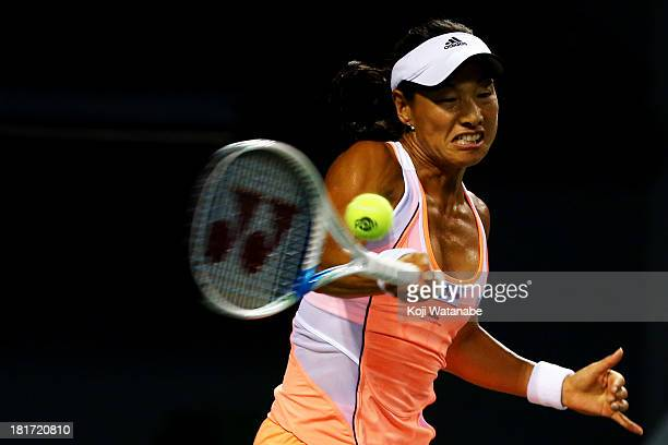 Kimiko DateKrumm of Japan in action during her women's singles second round match against Samantha Stosur of Australia during day three of the Toray...