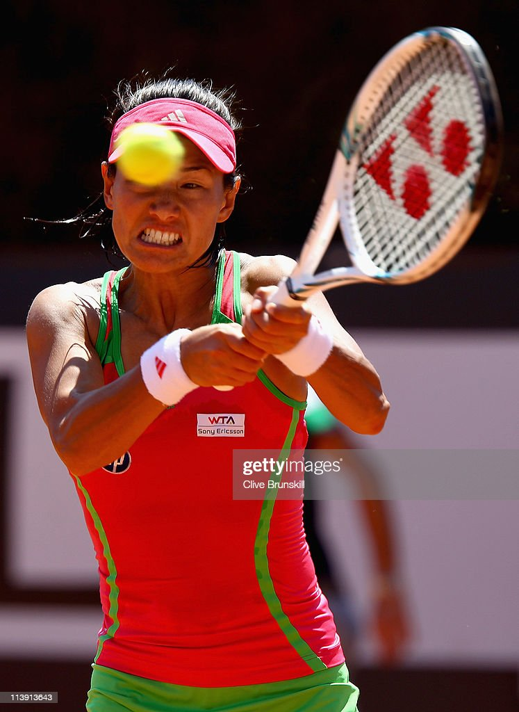 <a gi-track='captionPersonalityLinkClicked' href=/galleries/search?phrase=Kimiko+Date&family=editorial&specificpeople=623768 ng-click='$event.stopPropagation()'>Kimiko Date</a>-Krumm of Japan plays a backhand during first round match against Lucie Safarova of Czech Republic during day three of the Internazoinali BNL D'Italia at the Foro Italico Tennis Centre on May 10, 2011 in Rome, Italy.