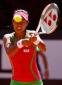 Kimiko DateKrumm of Japan plays a backhand during first round match against Lucie Safarova of Czech Republic during day three of the Internazoinali...