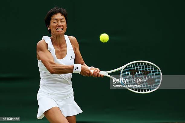 Kimiko DateKrumm of Japan plays a backhand during the Ladies' Singles first round match against Ekaterina Makarova of Russia on day one of the...