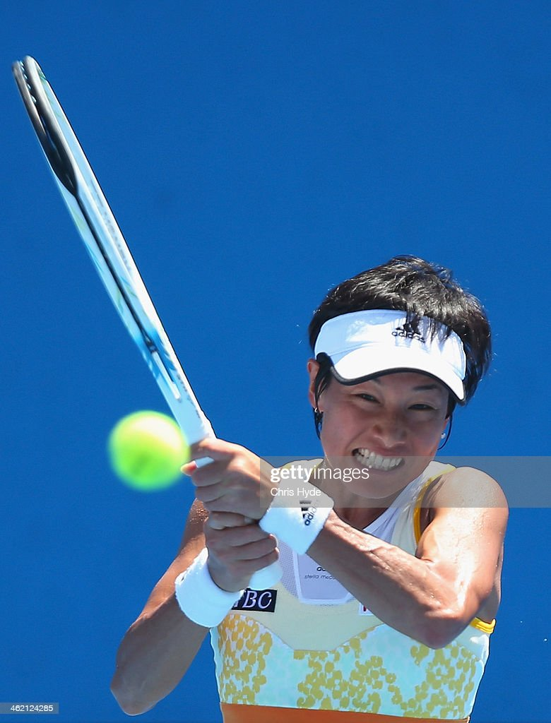 Kimiko DateKrumm of Japan plays a backhand in her first round match against Belinda Bencic of Switzerland during day one of the 2014 Australian Open...