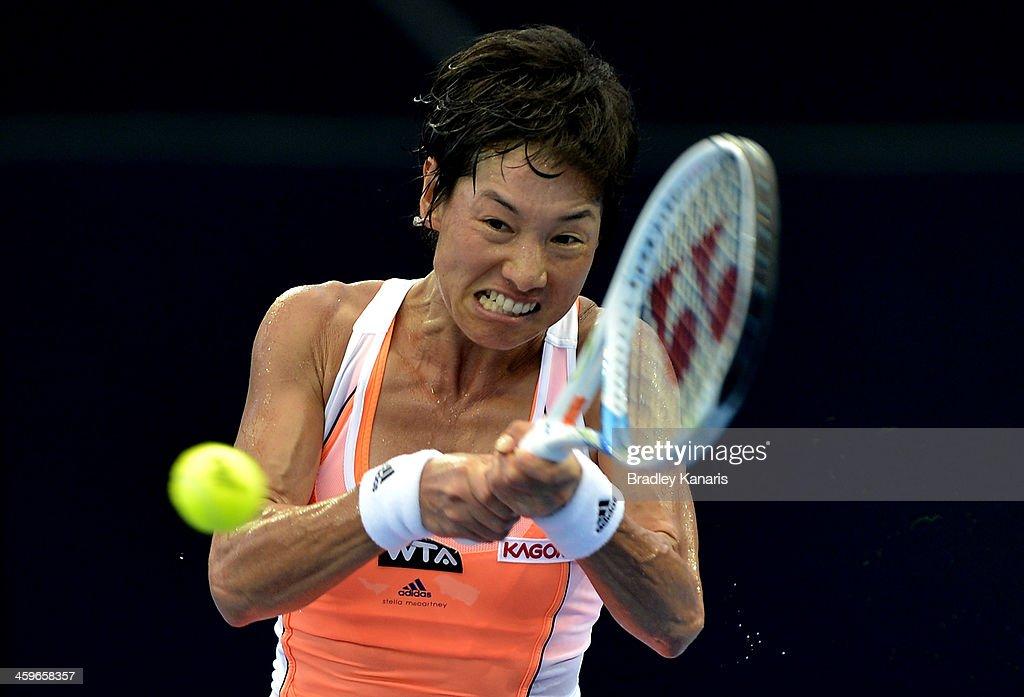 Kimiko DateKrumm of Japan plays a backhand in her match against Olivia Rogowska of Australia during day one of the 2014 Brisbane International at...