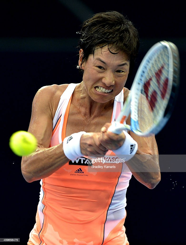 Kimiko Date-Krumm of Japan plays a backhand in her match against Olivia Rogowska of Australia during day one of the 2014 Brisbane International at Queensland Tennis Centre on December 29, 2013 in Brisbane, Australia.
