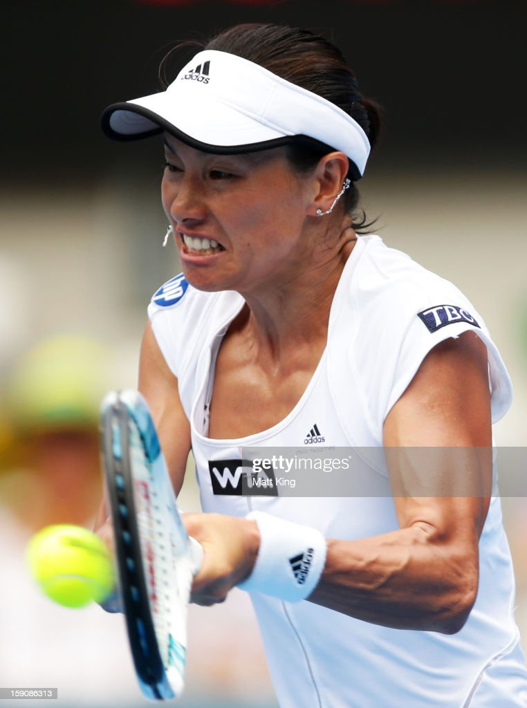 <a gi-track='captionPersonalityLinkClicked' href=/galleries/search?phrase=Kimiko+Date&family=editorial&specificpeople=623768 ng-click='$event.stopPropagation()'>Kimiko Date</a>-Krumm of Japan plays a backhand in her second round match against Agnieszka Radwanska of Poland during day three of Sydney International at Sydney Olympic Park Tennis Centre on January 8, 2013 in Sydney, Australia.