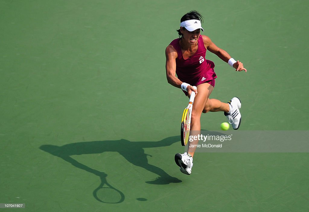 Kimiko Date-Krumm of Japan plays a backhand in the Women's seli-final match against Shuai Peng of China at the Aoti Tennis Centre during day nine of the 16th Asian Games Guangzhou 2010 on November 21, 2010 in Guangzhou, China.