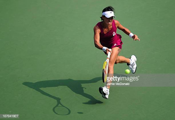 Kimiko DateKrumm of Japan plays a backhand in the Women's selifinal match against Shuai Peng of China at the Aoti Tennis Centre during day nine of...