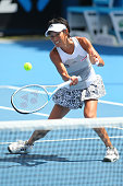 Kimiko DateKrumm of Japan plays a forehand in their first round doubles match with Casey Dellacqua of Australia against Shuai Peng of China and YiFan...