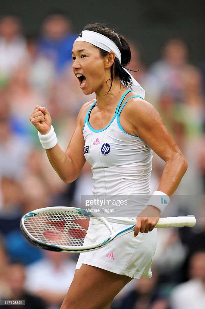 Kimiko DateKrumm of Japan reacts to a play during her second round match against Venus Williams of the United States on Day Three of the Wimbledon...