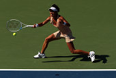 Kimiko DateKrumm of Japan returns a shot against Venus Williams of the United States during her women's singles first round match on Day One of the...