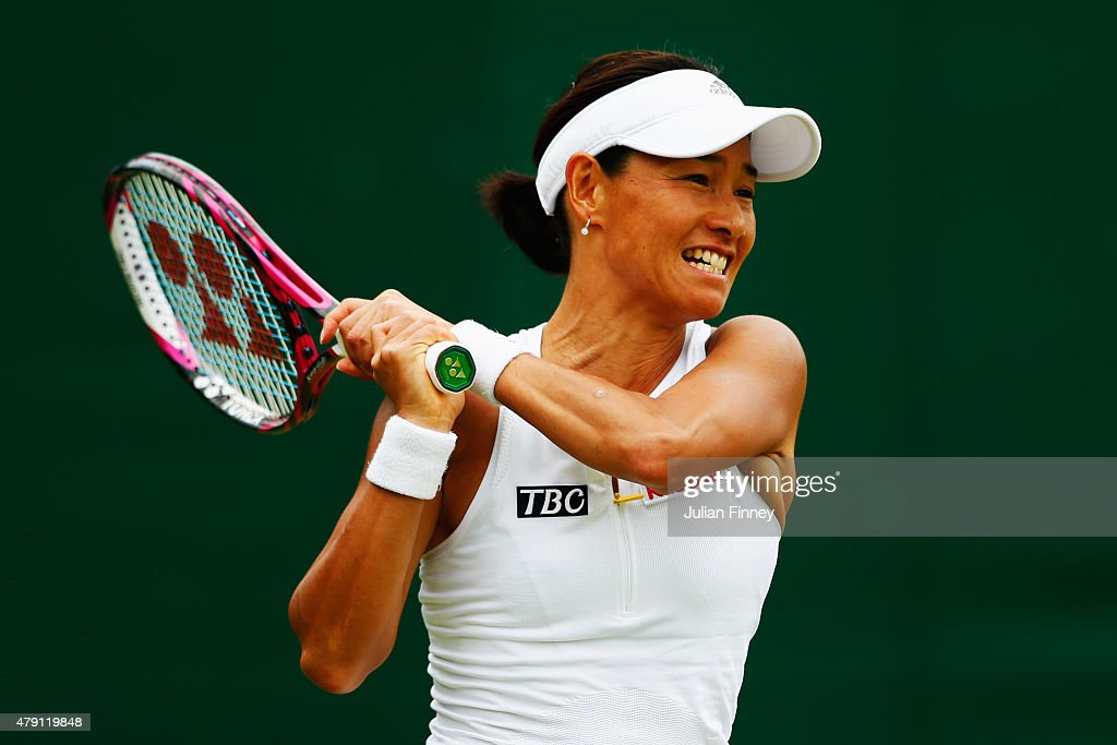 Kimiko DateKrumm of Japan returns a shot in her Ladies Doubles First Round match with Francesca Schiavone of Italy against Klaudia JanIgnacik of...