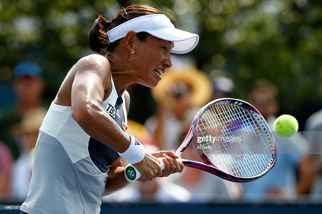 Kimiko DateKrumm of Japan returns a shot on Day Three of the 2015 US Open at the USTA Billie Jean King National Tennis Center on September 2 2015 in...