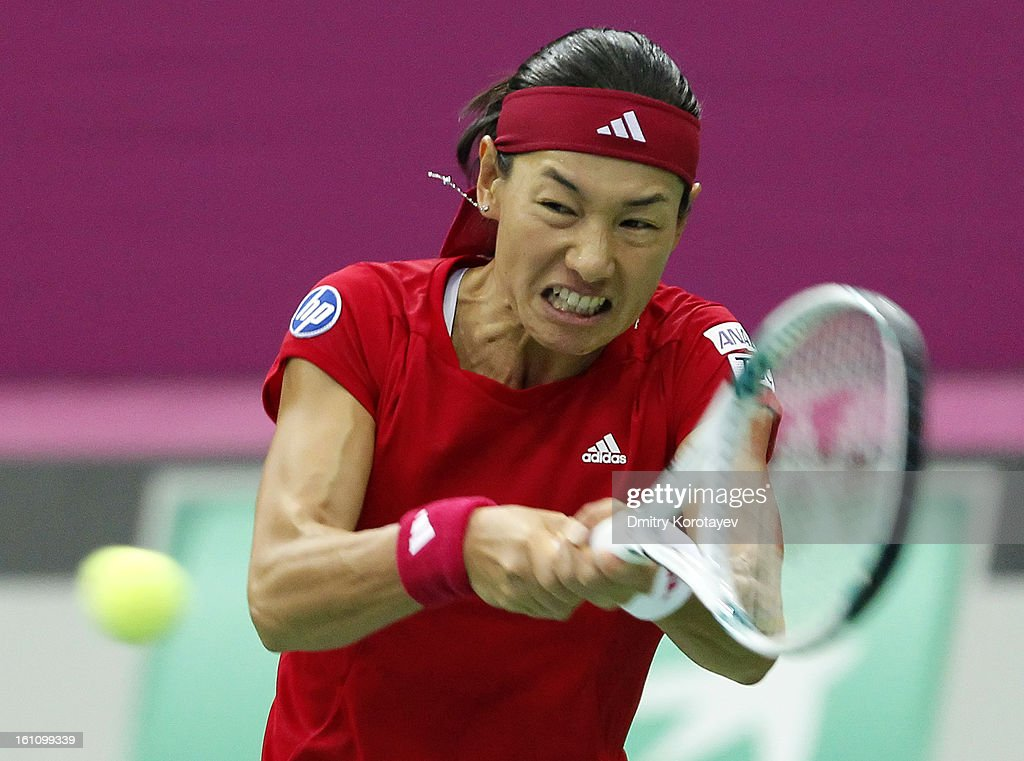 <a gi-track='captionPersonalityLinkClicked' href=/galleries/search?phrase=Kimiko+Date&family=editorial&specificpeople=623768 ng-click='$event.stopPropagation()'>Kimiko Date</a>-Krumm of Japan returns the ball against Maria Kirilenko of Russia during day one of the Federation Cup 2013 World Group Quarterfinal match between Russia and Japan, at Olympic Stadium on February 09, 2013 in Moscow, Russia.