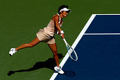 Kimiko DateKrumm of Japan serves against Venus Williams of the United States during her women's singles first round match on Day One of the 2014 US...