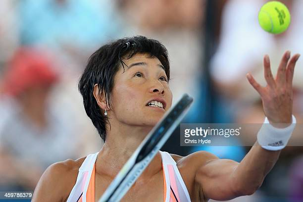 Kimiko DateKrumm of Japan serves in her match against Dominika Cibulkova of Slovakia during day three of the 2014 Brisbane International at...