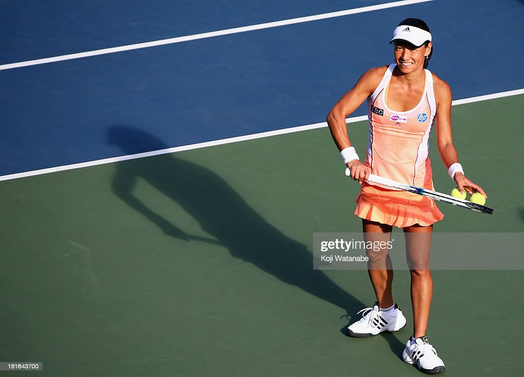 Kimiko Date-Krumm of Japan smiles after winning her women's singles first round match against Anastasia Rodionova of Australia during day two of the Toray Pan Pacific Open at Ariake Colosseum on September 23, 2013 in Tokyo, Japan.