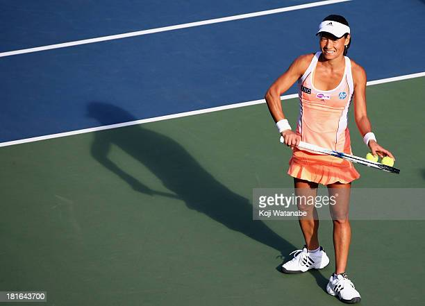 Kimiko DateKrumm of Japan smiles after winning her women's singles first round match against Anastasia Rodionova of Australia during day two of the...