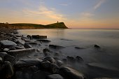 Summer Sunset at Kimmeridge Bay. Long exposure to blur the water movement between the rocks.