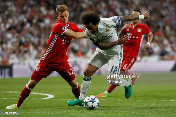 Kimmich of Bayern Muenchen and Marcelo of Real Madrid battle for the ball during the UEFA Champions League Quarter Final second leg match between...