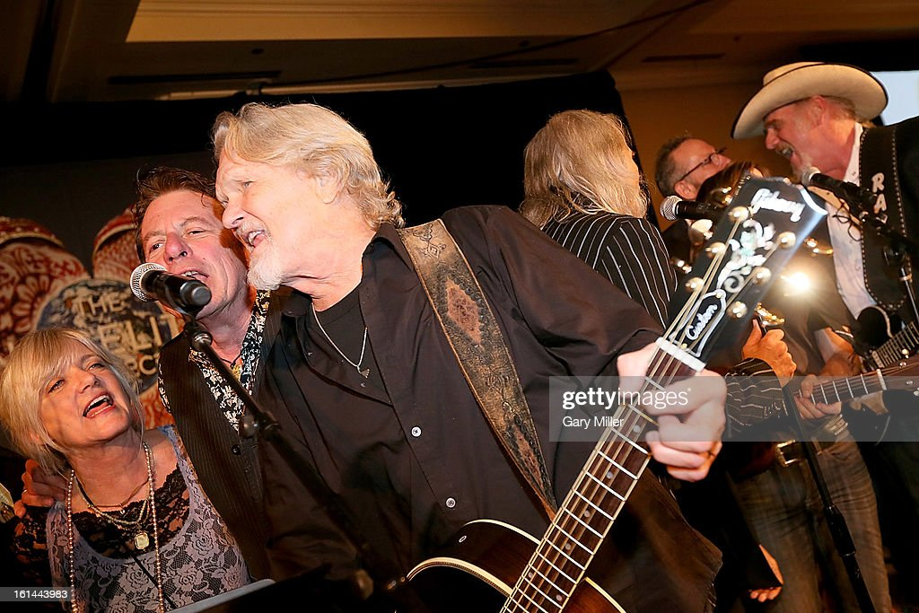 Kimmie Rhodes, Joe Ely, Kris Kristofferson and Ray benson perform during the Nobelity Projects Artists & Filmmakers Dinner honoring Kris Kristofferson with the Feed The Peace award at the Four Seasons Hotel on February 10, 2013 in Austin, Texas.