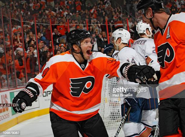 Kimmo Timonen and Jeff Carter of the Philadelphia Flyers celebrate a goal by Carter against the Edmonton Oilers during the second period of an NHL...