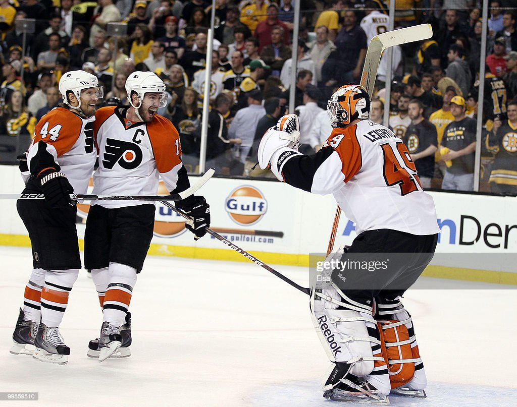 Kimmo Timonen #44 and Mike Richards #18 of the Philadelphia Flyers celebrates the win with goalie Michael Leighton #49 after defeated the Boston Bruins in Game Seven of the Eastern Conference Semifinals during the 2010 NHL Stanley Cup Playoffs at TD Garden on May 14, 2010 in Boston, Massachusetts. The Flyers defeated the Bruins 4-3.