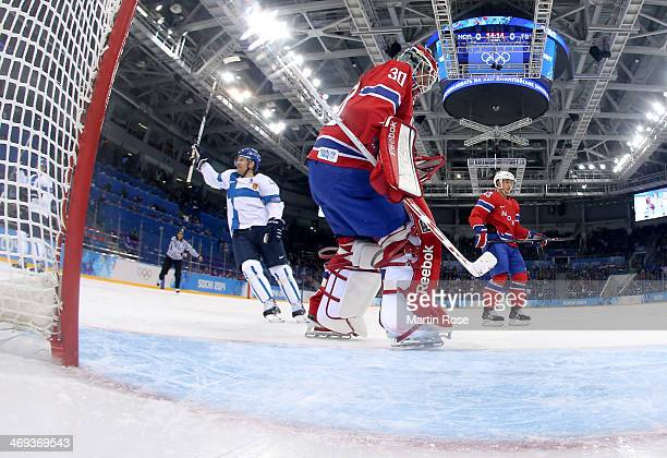 Kimmo Timonen of Finland celebrates after a goal in the first period by Teemu Selanne against Lars Haugen of Norway during the Men's Ice Hockey...