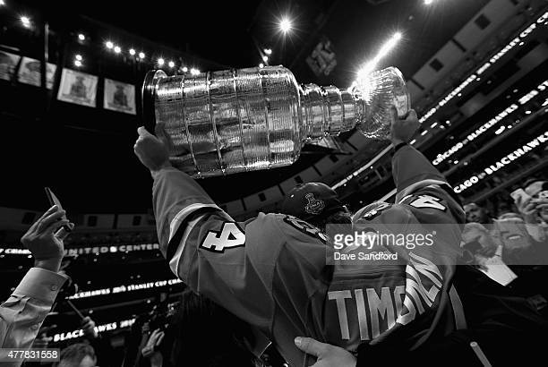 Kimmo Timonen of the Chicago Blackhawks lifts the Stanley Cup in celebration after his team defeated the Tampa Bay Lightning 20 in Game Six of the...