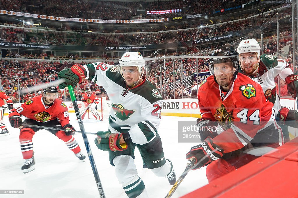 Kimmo Timonen #44 of the Chicago Blackhawks skates around the boards against Nino Niederreiter #22 and Chris Stewart #44 of the Minnesota Wild in Game One of the Western Conference Semifinals during the 2015 NHL Stanley Cup Playoffs at the United Center on May 1, 2015 in Chicago, Illinois.