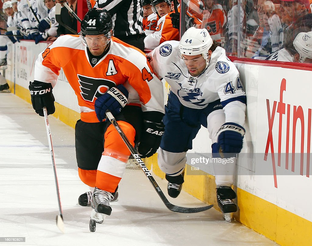 Kimmo Timonen #44 of the Philadelphia Flyers and Nate Thompson #44 of the Tampa Bay Lightning fight for the puck in the first period on February 5, 2013 at the Wells Fargo Center in Philadelphia, Pennsylvania.