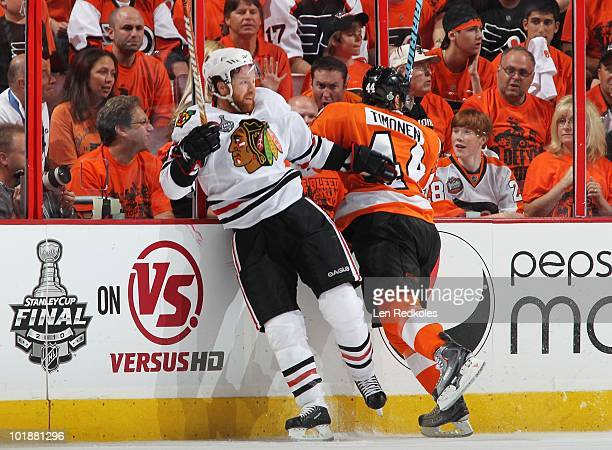 Kimmo Timonen of the Philadelphia Flyers battles Brian Campbell of the Chicago Blackhawks in Game Four of the 2010 NHL Stanley Cup Final at the...